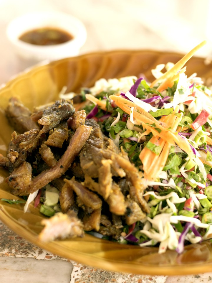 The local dish, khao yam, is best described as a rice salad with vegetables and herbs