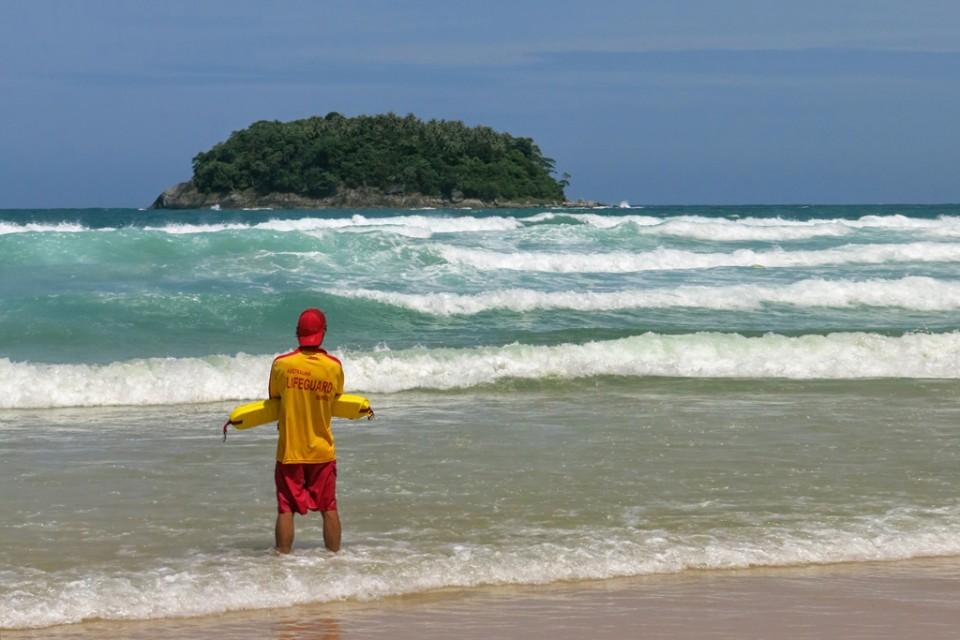 A lifeguard on Kata Beach keeps a close eye on the waves.