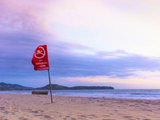 It really is quite simple: Red flag, Don't swim!